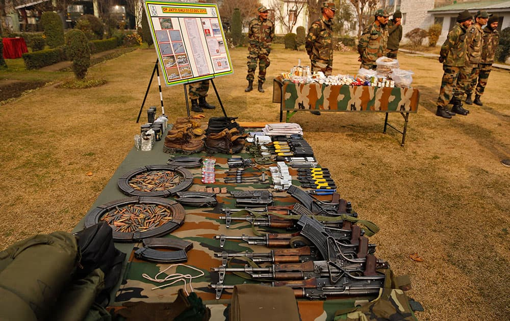 Indian army soldiers display before the media arms and ammunition they claim to have seized from insurgents in Srinagar, India.