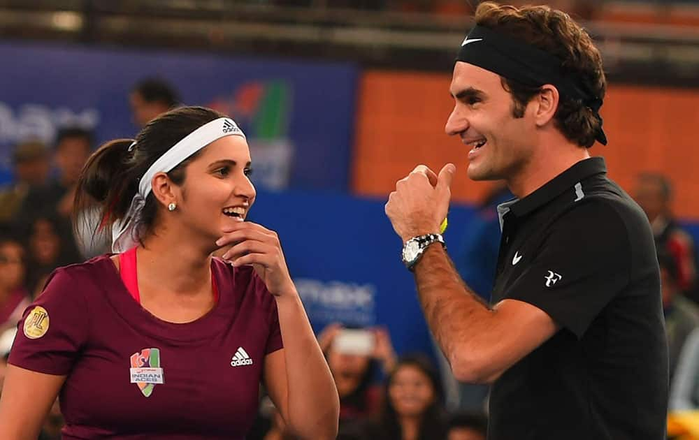MICROMAX INDIA ACES, SANIA MIRZA AND ROGER FEDERER DURING THEIR MIX DOUBLES MATCH AGAINST SINGAPORE SALMMERS AT THE INTERNATIONAL PREMIER TENNIS LEAGUE (IPTL) AT IGI STADIUM IN NEW DELHI.