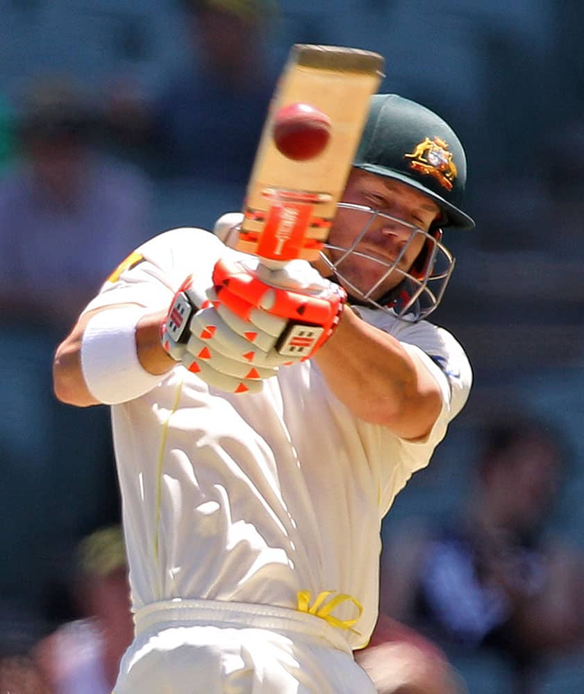 Australia's David Warner pulls the ball during the first day of the cricket match against India in Adelaide, Australia.