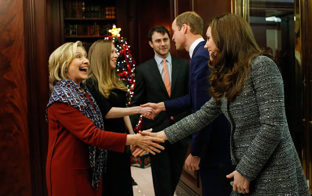Kate, the Duchess Of Cambridge, right, shakes hands with Hillary Rodham Clinton while attending a reception with Prince William, second from right, co-hosted by the Royal Foundation and the Clinton Foundation at British Consul General's Residence in New York.