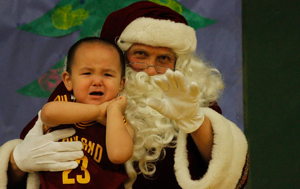 This photo shows a crying child unsure of what to make of Santa Claus in Shishmaref, Alaska.