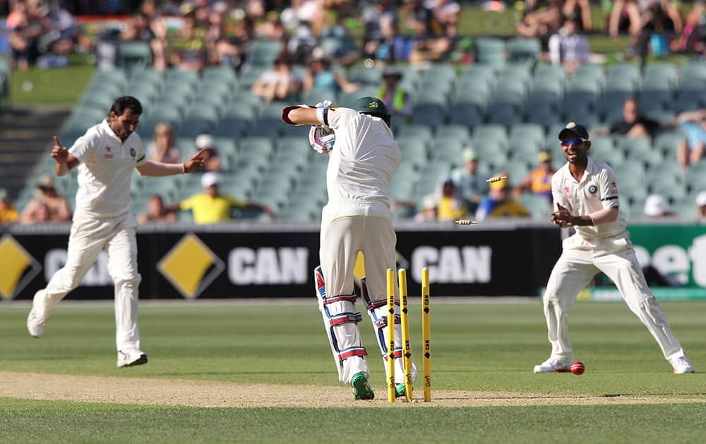 Mohammed Shami, bowls Australia's Nathan Lyon, during the first day of the cricket match in Adelaide, Australia.