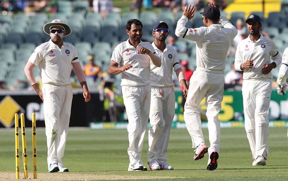 Mohammed Shami celebrates the wicket of Australia's Nathan Lyon, during the first day of the cricket match in Adelaide, Australia.