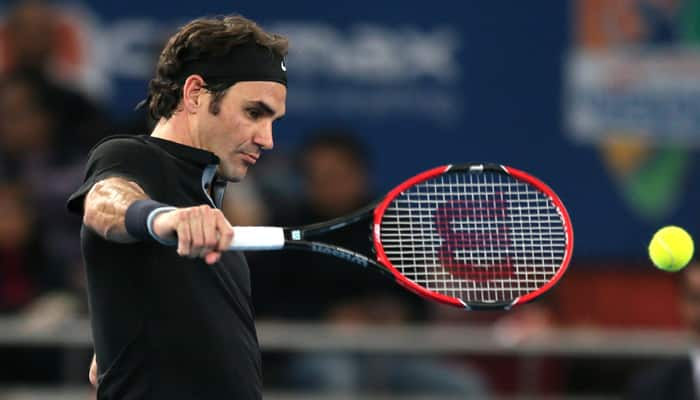 Overwhelmed Roger Federer says he would be back in India