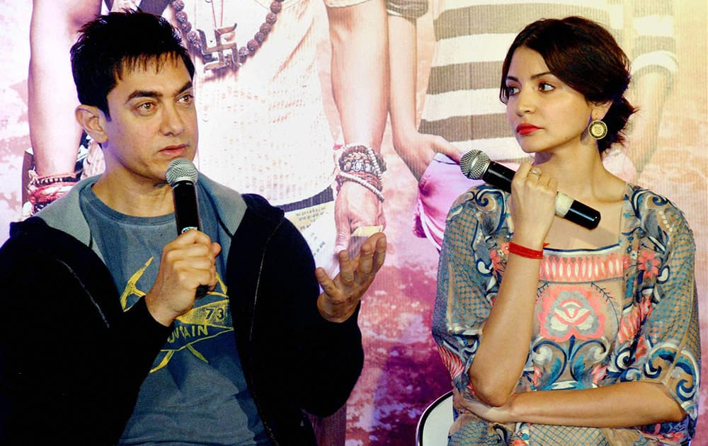 Aamir Khan and actress Anushka Sharma talking to the media during the promotion of their upcoming film PK at PVR Banjara Hills in Hyderabad.