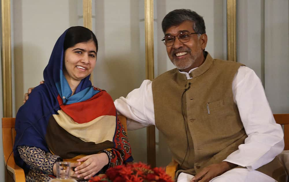 Joint-Nobel Peace prize winners Malala Yousafzai and Kailash Satyarthi attend a press conference in Oslo, Norway.