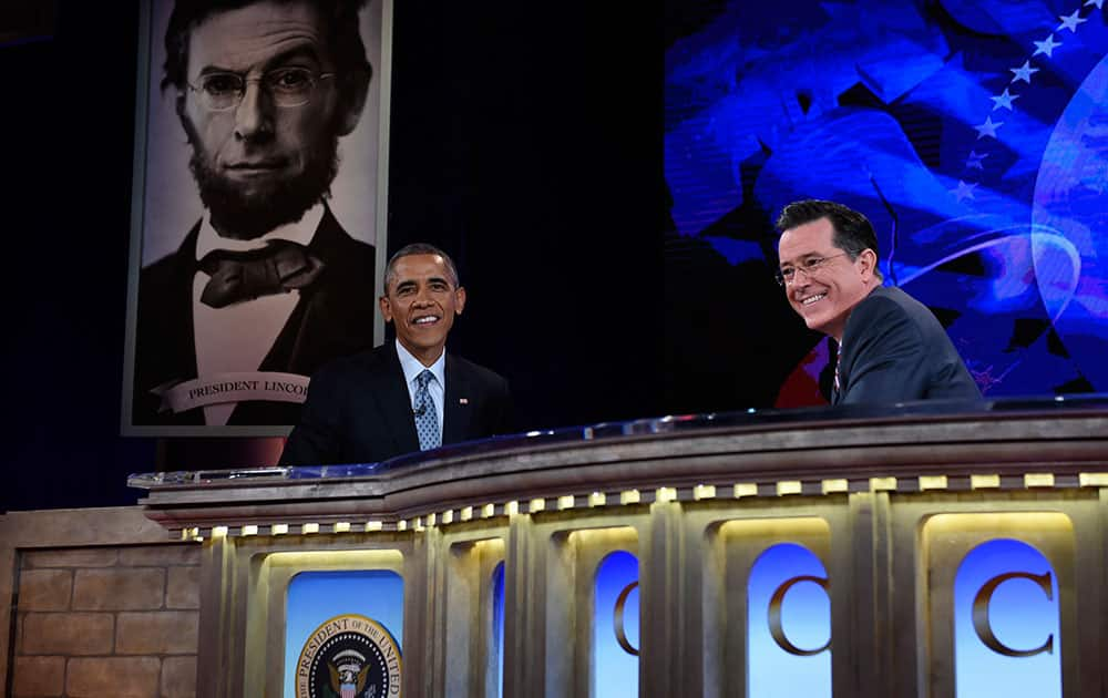 President Barack Obama talks with Stephen Colbert of The Colbert Report during a taping of The Colbert Report program in Lisner Auditorium at George Washington University in Washington.