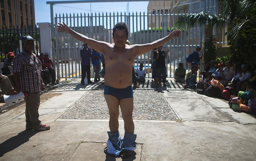 A former sugar cane worker and chronic renal failure patient, undresses during a protest in front of the National Assembly after a march from Chichigalpa to Managua, demanding compensation for damages to their health resulting from alleged exposure to agrochemicals and pesticides, in Managua, Nicaragua.
