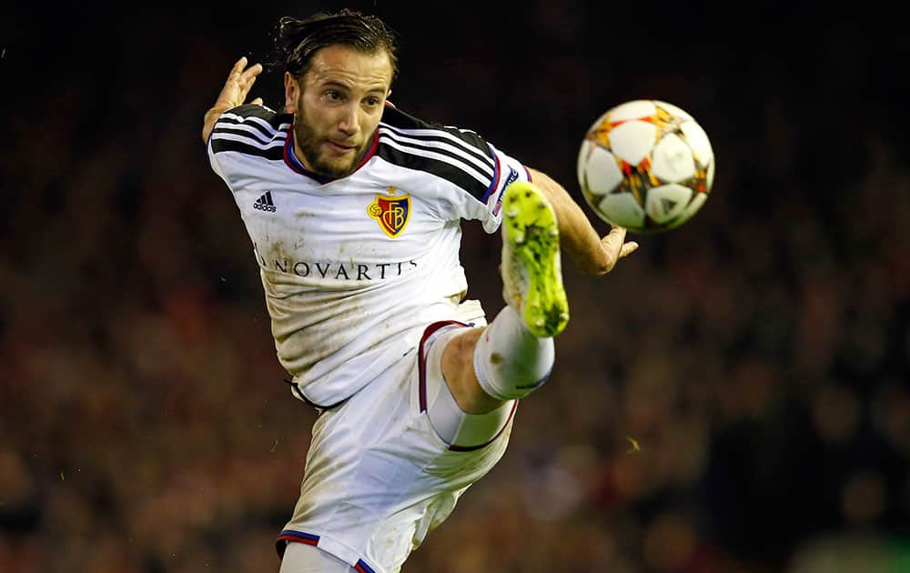 Basel's Shkelzen Gashi clears the ball during the Champions League Group B soccer match between Liverpool and FC Basel at Anfield Stadium in Liverpool, England.