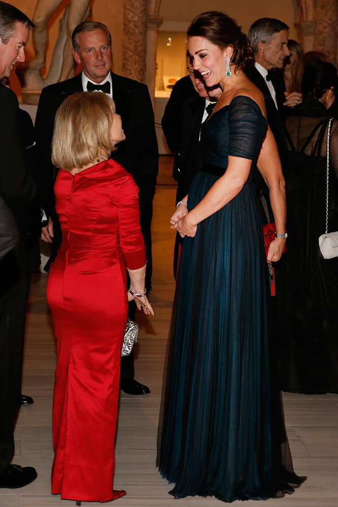Kate, Duchess of Cambridge, right, attends the St. Andrews 600th Anniversary Dinner at the Metropolitan Museum of Art, in New York.