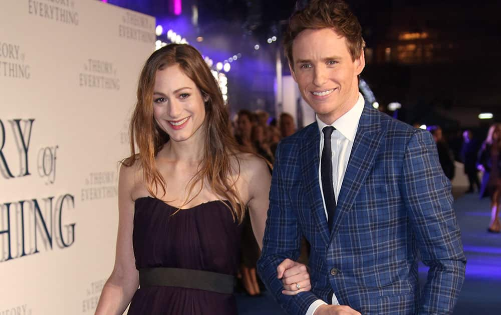 Actor Eddie Redmayne and Hannah Bagshawe arrive on the blue carpet for the UK premiere of The Theory Of Everything at the Odeon in Leicester Square, central London