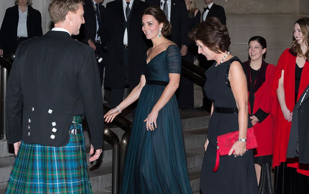Kate, Duchess of Cambridge, arrives at the Metropolitan Museum of Art, in New York. Britain's Prince William and the Duchess of Cambridge are on the last of their 3-day tour of New York City, their first visit to the United States since a trip to California in 2011.