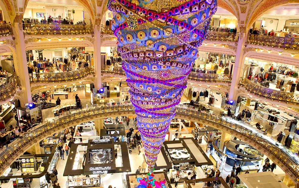 An inverted Christmas tree stands at the center of the department store Galeries Lafayette in Paris, France.