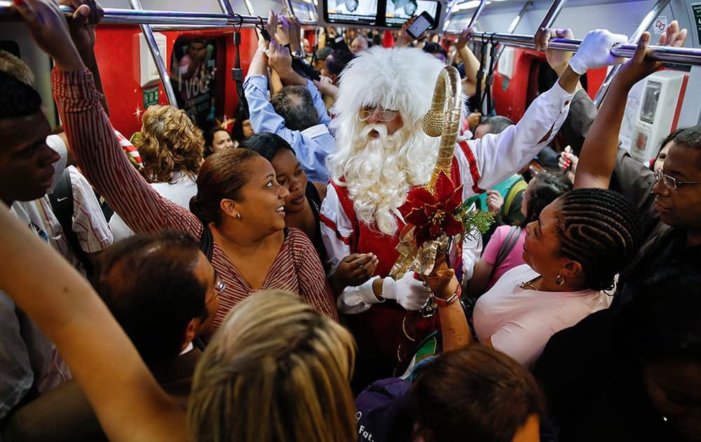 A man dressed as Santa Claus rides a crowded subway train in Sao Paulo, Brazil.