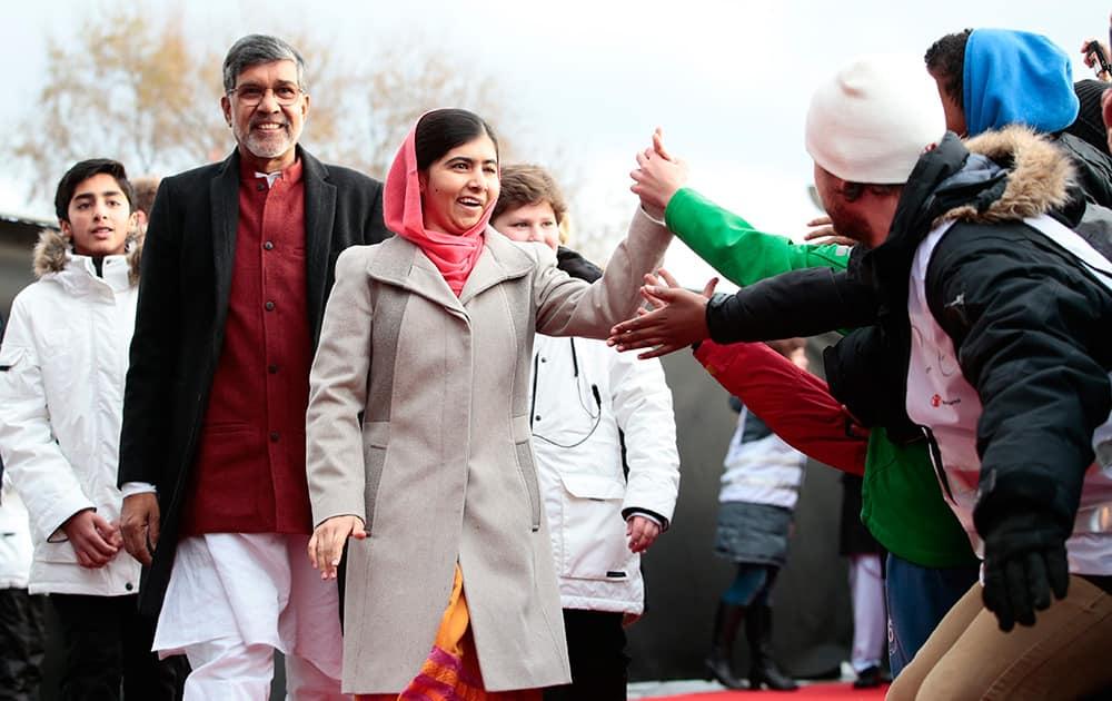 Nobel Peace Prize laureates Kailash Satyarthi and Malala Yousafzai arrive at Save the Children (Redd Barna) peace prize festivities in Oslo.