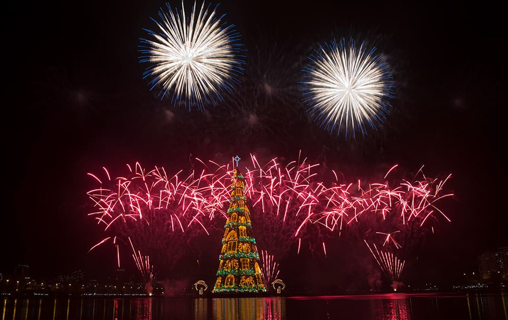 Fireworks explode over the floating Christmas tree in Lagoa lake at the annual holiday tree lighting event in Rio de Janeiro, Brazil.