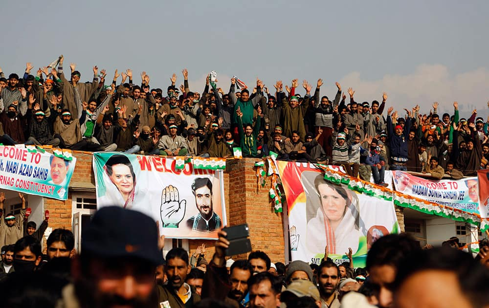 Kashmiris gather for an election rally addressed by Congress party leader Sonia Gandhi at Shangas, some 78 kilometers south of Srinagar, Kashmir.