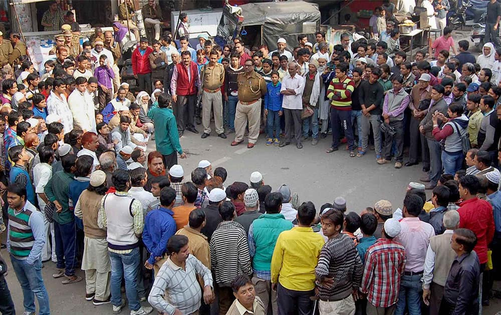 Muslims holding a protest against alleged conversion of some of families of the community, in Agra.