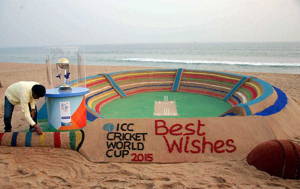 Sand Artist Sudarshan Patnaik creates a sand art welcoming the ICC World Cup at Golden Beach in Puri.