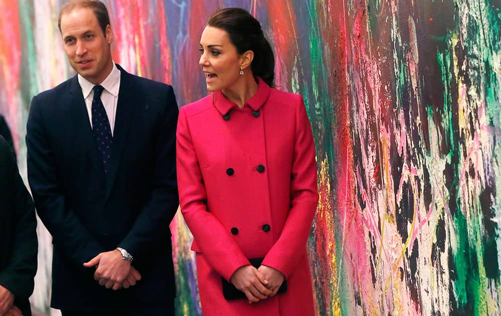 BRITAIN'S PRINCE WILLIAM, DUKE OF CAMBRIDGE, LEFT, AND KATE, DUCHESS OF CAMBRIDGE, WALK IN FRONT OF A MURAL BY JOSE PARLA AS THE ROYAL COUPLE TAKES A TOUR OF THE LOBBY OF NEW ONE WORLD TRADE CENTER FOLLOWING A VISIT TO THE NEARBY NATIONAL SEPTEMBER 11 MEMORIAL AND MUSEUM, IN NEW YORK.