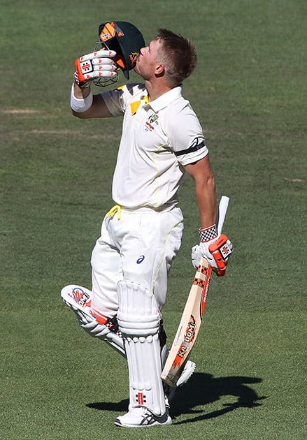 Australia's David Warner celebrates his 100, during the fourth day of their cricket test match in Adelaide.
