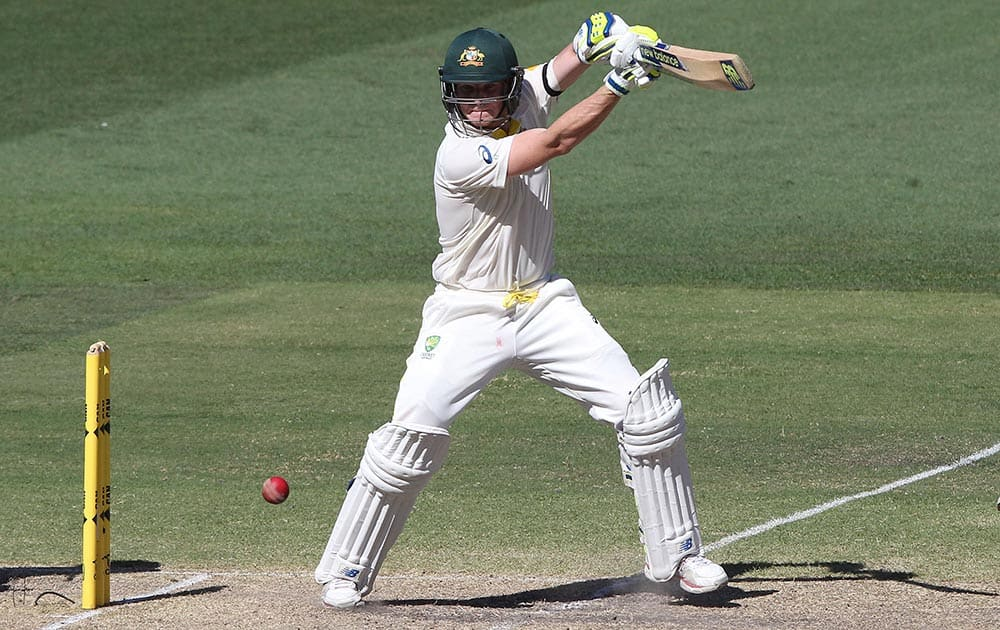 Australia's Steven Smith plays a shot, during the fourth day of their cricket test match in Adelaide, Australia.