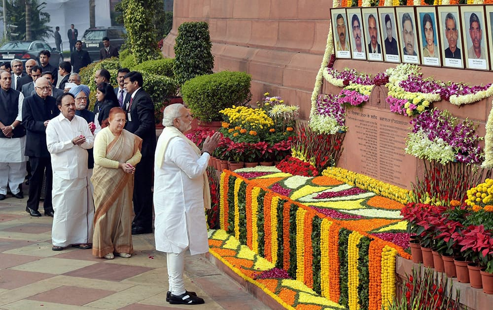 Prime Minister Narendra Modi, Lok Sabha Speaker Sumitra Mahajan and other dignitaries paying tributes to the martyrs of 2001 Parliament attack on its 13th anniversary, at Parliament House in New Delhi.