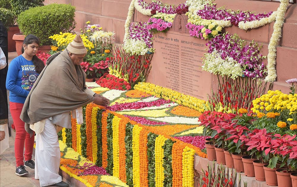 Family members of the martyred security guard J P Yadav paying tributes to the martyrs of 2001 Parliament attacks on its 13th anniversary, in New Delhi.