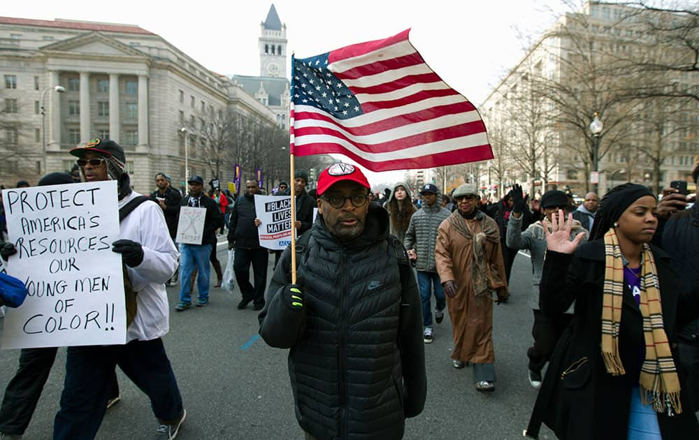 Film director Spike Lee, and others, march on Pennsylvania Avenue toward Capitol Hill in Washington.