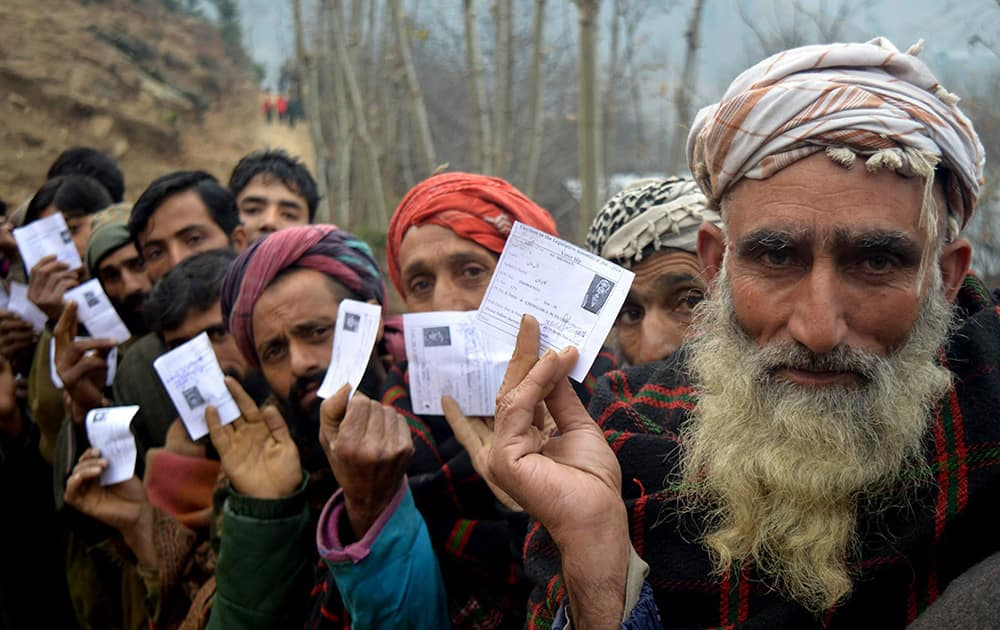 Kashmiris stand in a long queue as they wait to cast their vote at in a polling station in the 4th phase of state assembly election in Jammu and Kashmir.