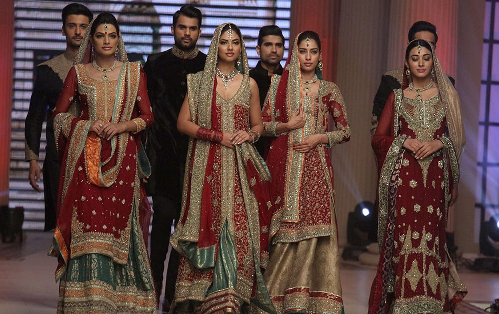 Pakistani models present creations by designer Mehdi during the second day of Telenor Bridal Couture Week 2014, in Lahore.