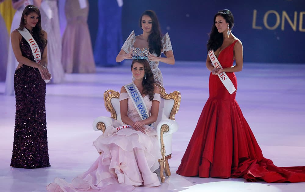 Miss South Africa Rolene Strauss is crowned Miss World 2014 by last year's winner Megan Young, at the end of the competition at the ExCel centre in London. Miss Hungary Edina Kulcsar, left, was second with Miss United States, Elizabeth Safrit finishing third.