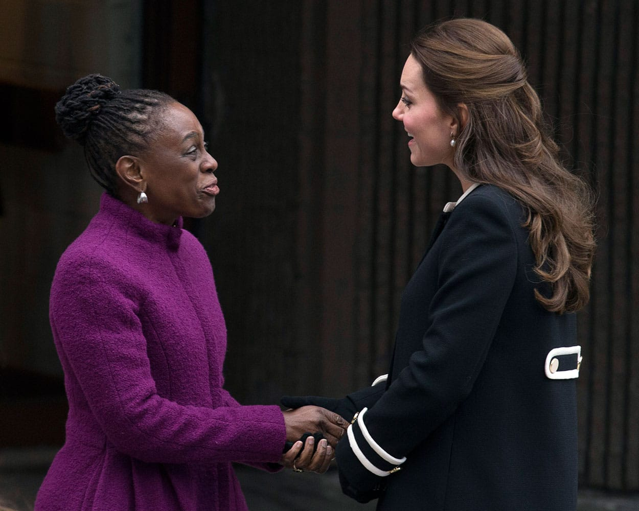 New York City first lady Chirlane McCray, left, and Britain's Kate, Duchess of Cambridge, shake hands outside the Northside Center for Child Development, Monday, Dec. 8, 2014, in New York.