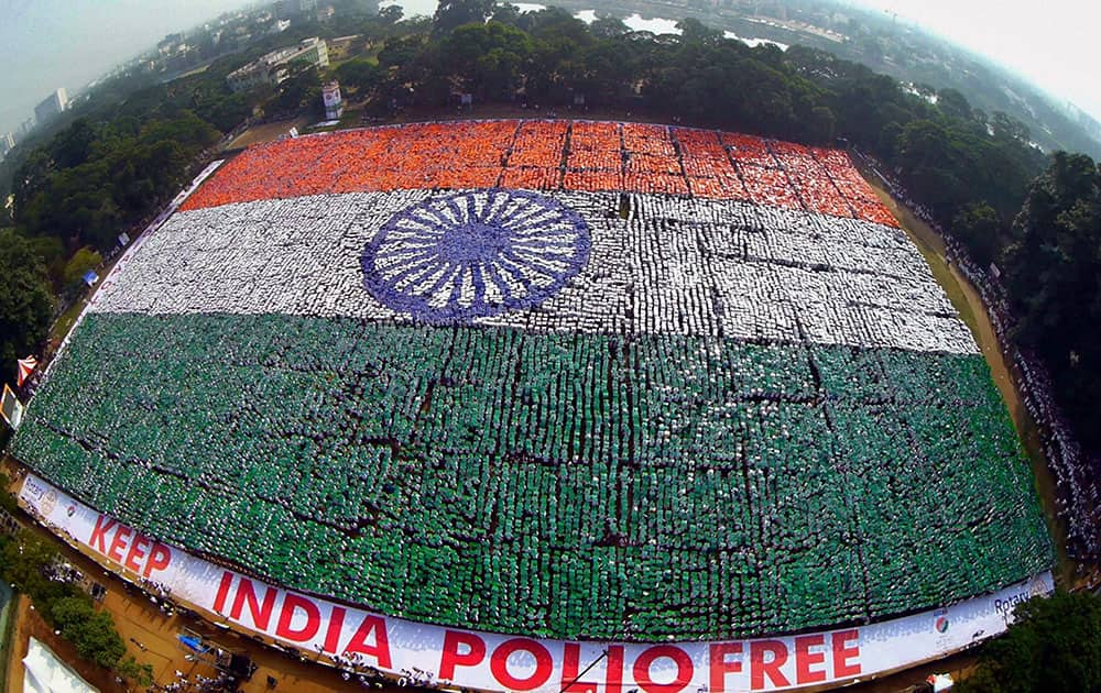 In this Sunday, Dec. 7, 2014 photo, an aerial picture shows the Indian national flag formed by volunteers seeking to set a Guinness Record for the largest human flag formation at Nandanam YMCA ground in Chennai, India.
