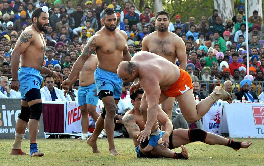 Players in action during the 5th World Cup Kabaddi match between India and Iran in Patiala.