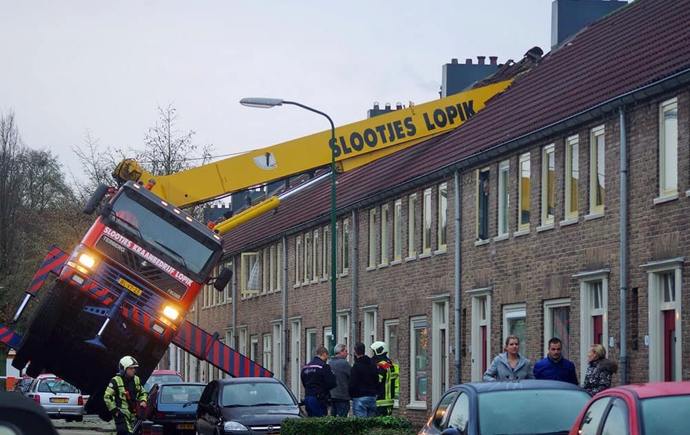 A crane which crashed into the roof of a house is seen following an unusual marriage proposal by a man who wished to be lifted in front of the bedroom window of his girlfriend to ask for her hand in marriage, in the central Dutch town of IJsselstein.