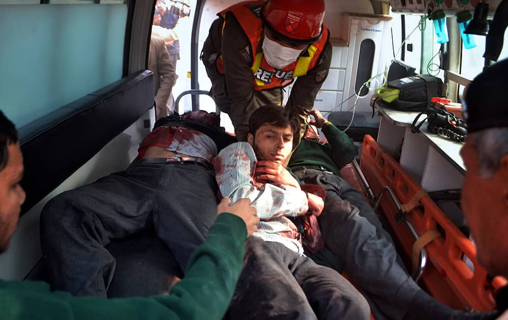 Pakistani rescue workers take out students from an ambulance who injured in the shootout at a school under attack by Taliban gunmen, upon arrival at a local hospital in Peshawar, Pakistan.