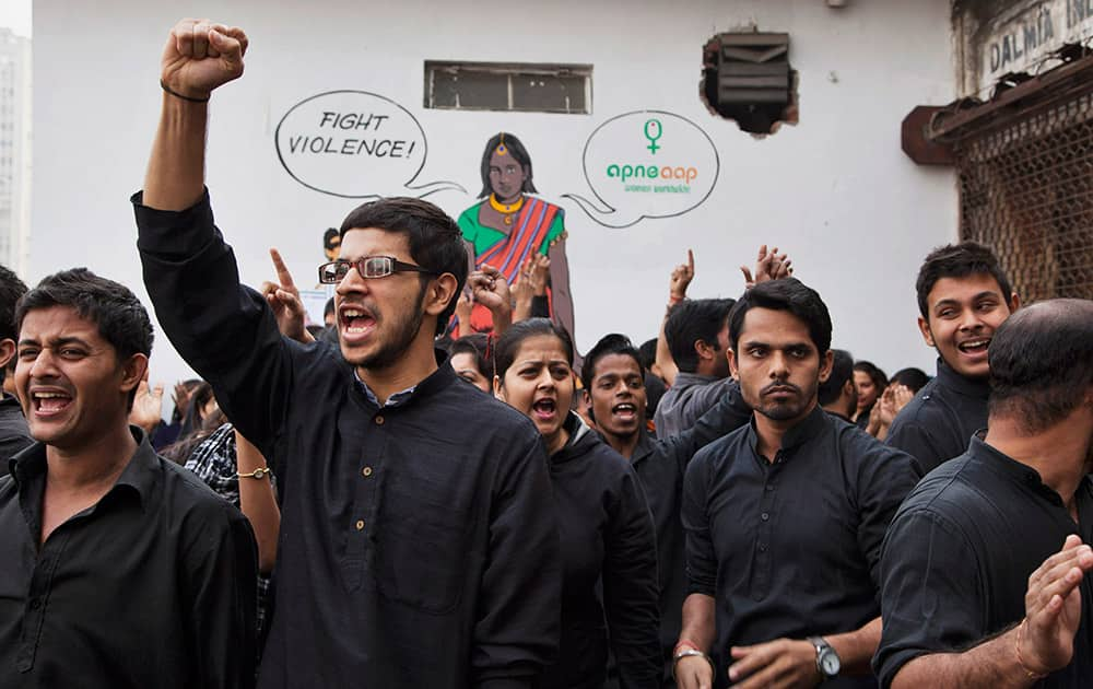 Students perform a street play to create awareness on violence against women during a protest ahead of the second anniversary of the deadly gang rape of a 23-year-old physiotherapy student on a bus, in New Delhi, India.