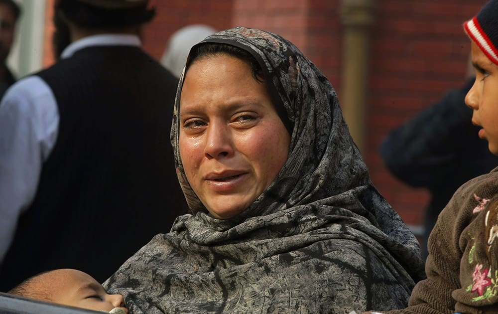 A Pakistani woman weeps as she waits at a hospital, where victims of a Taliban attack are being treated in Peshawar, Pakistan.