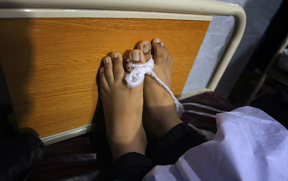 The feet of a victim of a Taliban attack in a school are tied together at a local hospital in Peshawar, Pakistan.