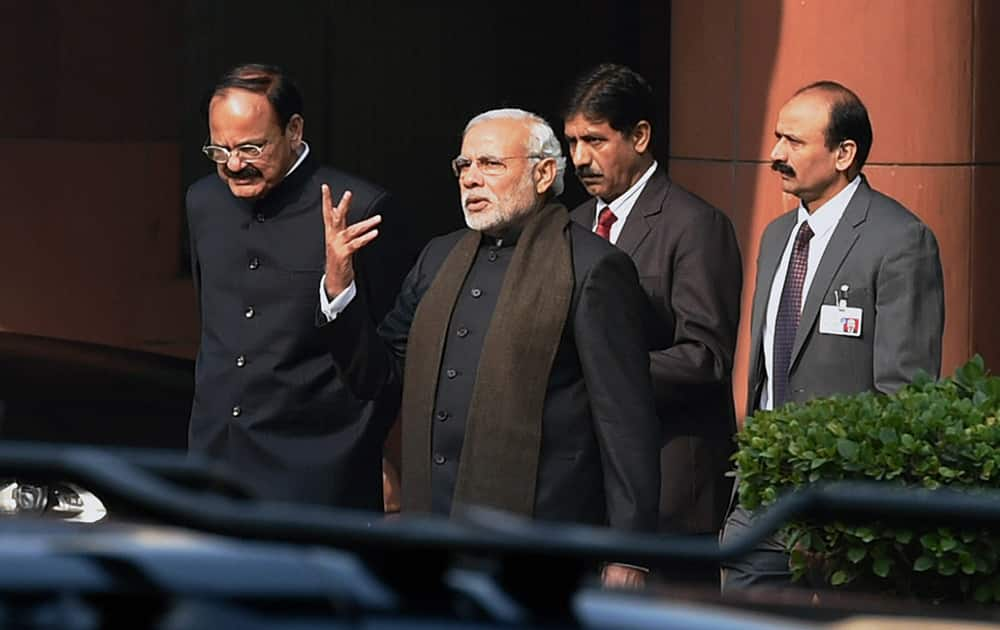 Prime Minister Narendra Modi with Parliamentary Affairs Minister M Venkaiah Naidu leaves after the BJP Parliamentary Party meeting at Parliament in New Delhi.