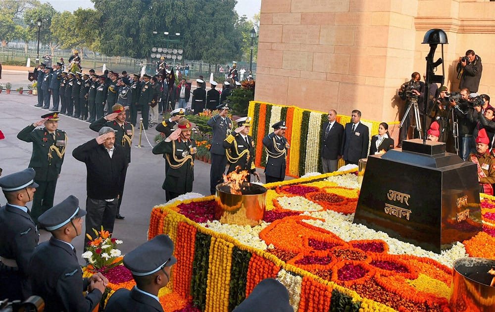 Defence Minister Manohar Parrikar along with Air Chief Marshal Arup Raha, Naval Chief Admiral RK Dhowan and Army chief Gen Dalbir Singh pays homage to the martyrs at Amar Jawan Jyoti on the occassion of Vijay Diwas in New Delhi.