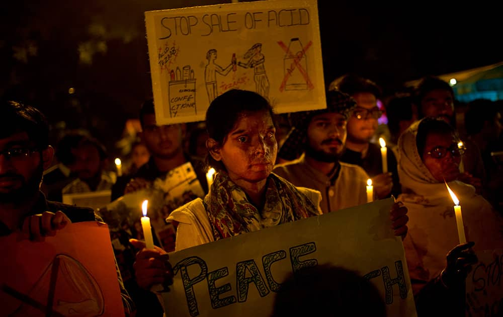 Acid attack survivors participate in a candlelit vigil protesting violence against women as they mark the second anniversary of the deadly gang rape of a student on a bus, in New Delhi.