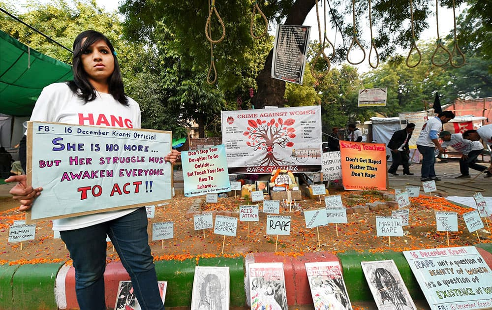 A girl holding a placard on the second anniversary of the deadly gang rape of a student on a bus, in New Delhi.