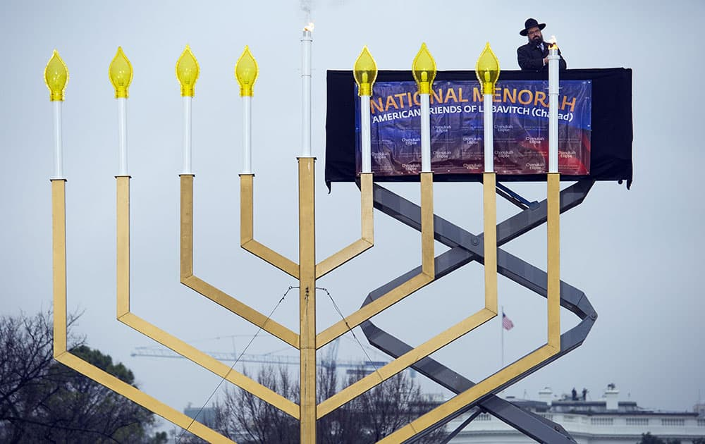 Rabbi Abraham Shemtov,national director of American Friends of Lubavitch (Chabad) lights the national menorah during a ceremony marking the start of the celebration of Hanukkah, on the Ellipse near the White House in Washington.