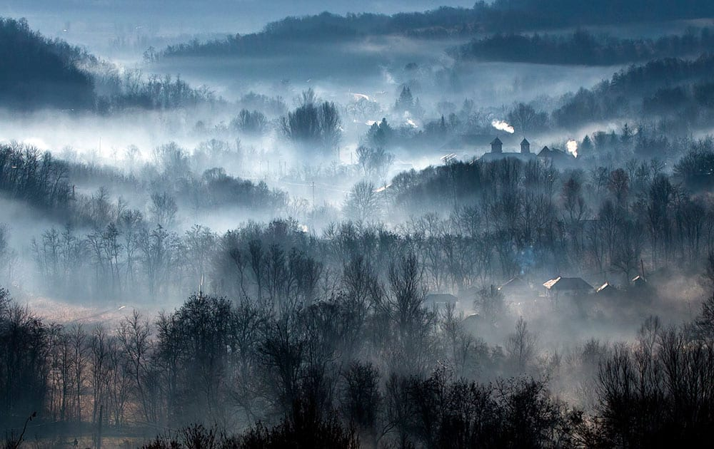 Morning fog engulfs a village outside Izbasesti, Romania. Severe fog affected large areas of Romania causing traffic disruptions.