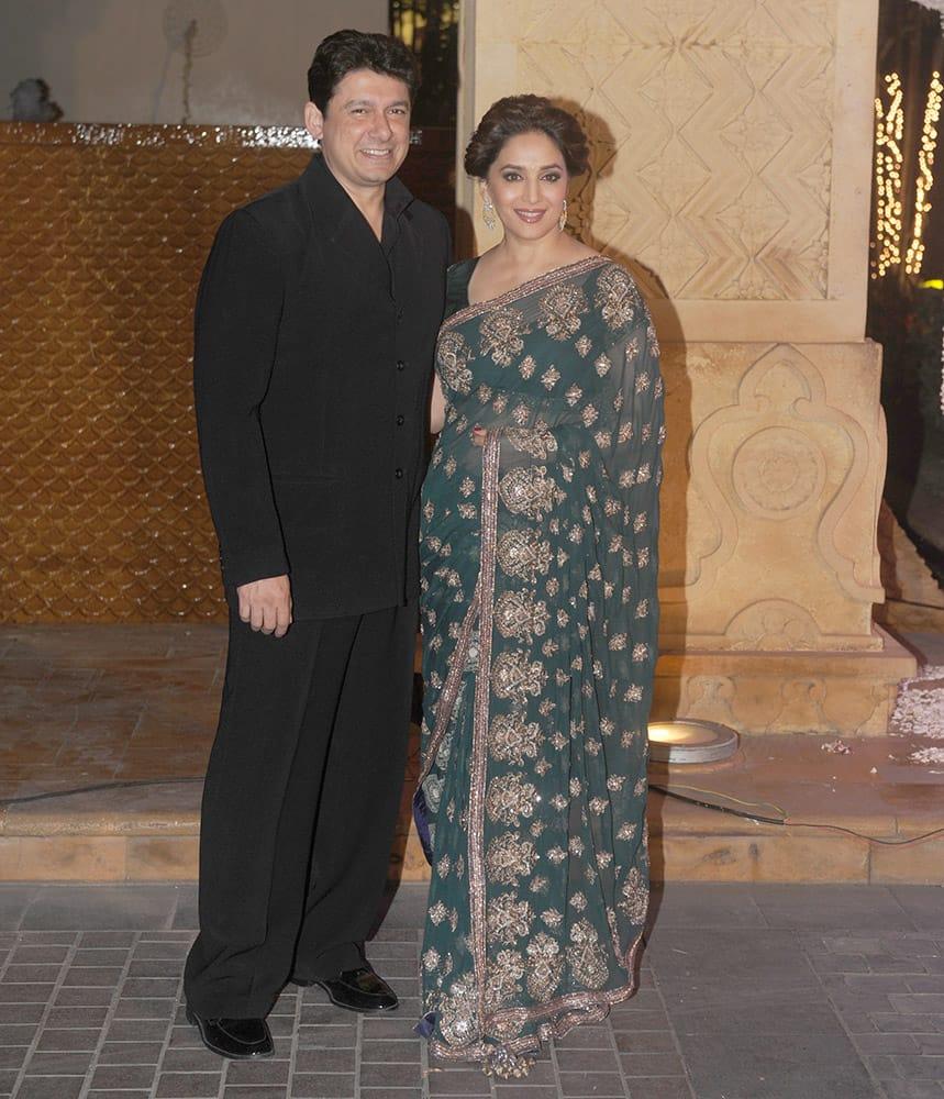 Sriram Nene, Madhuri Dixit Nene during Riddhi Malhotra and Tejas Talwalkar marriage reception in Mumbai.- dna