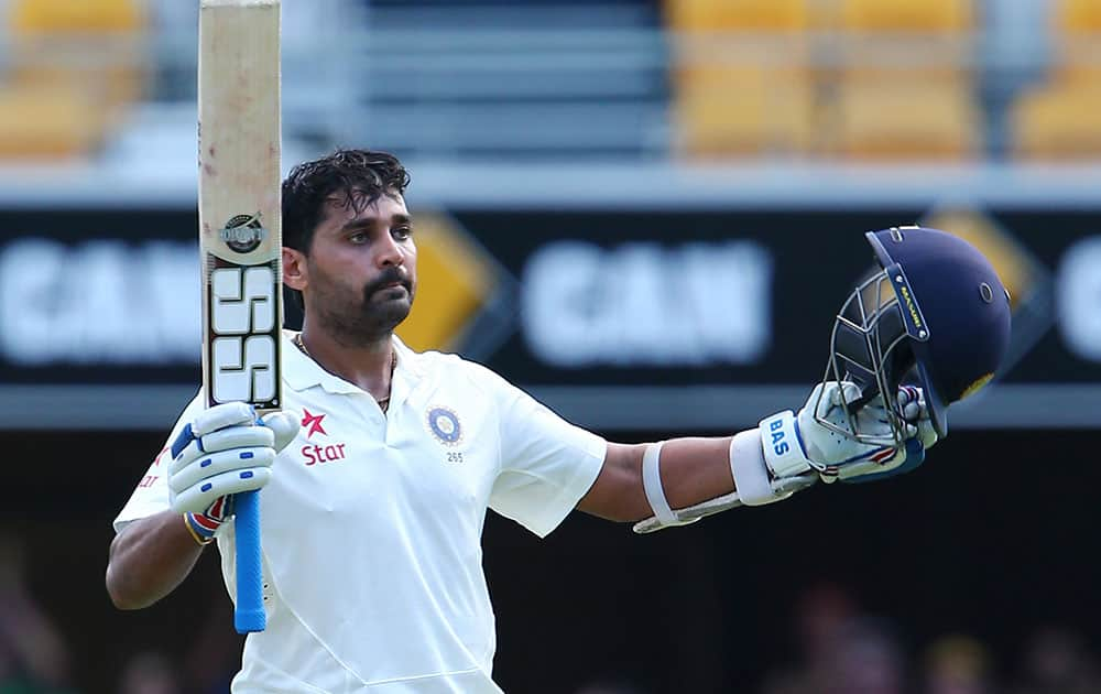 India's Murali Vijay celebrates after scoring a century on day one of the second cricket test against Australia in Brisbane, Australia.