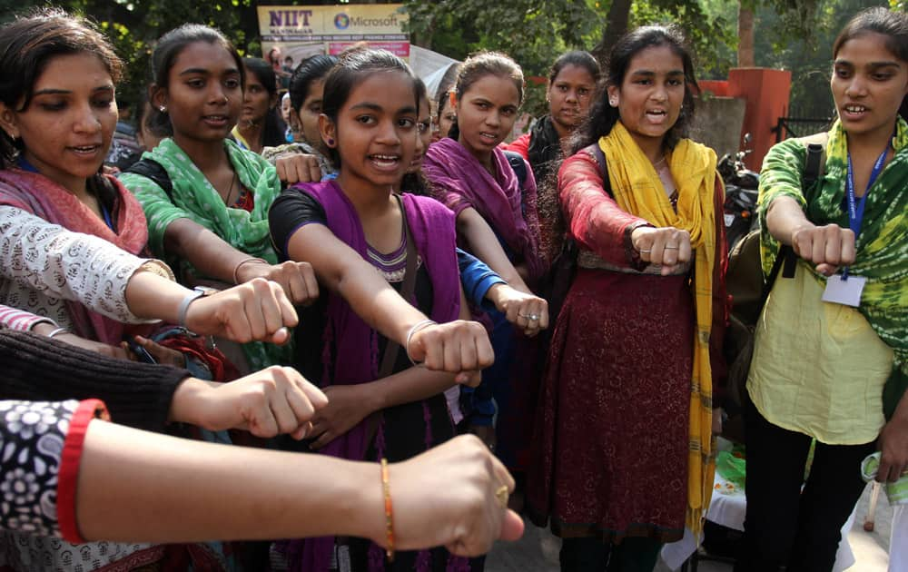 Indian girls take a pledge to act towards stopping atrocity on women on the second anniversary of the deadly gang rape of a student on a bus in New Delhi, in Ahmadabad, India.