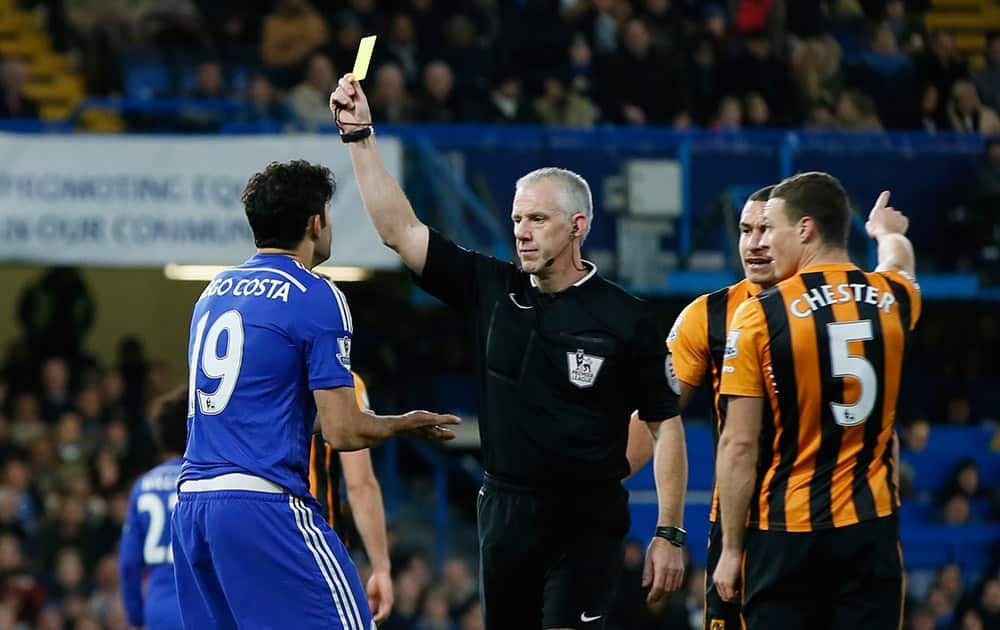 Chelsea's Diego Costa is shown a yellow card by referee Chris Hoy during their English Premier League soccer match between Chelsea and Hull City at Stamford Bridge stadium in London.